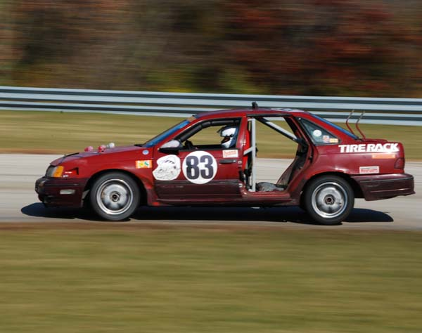 Red Rocket Ratnest Revival Ford Taurus SHO at 24 Hours of LeMons Chicago race