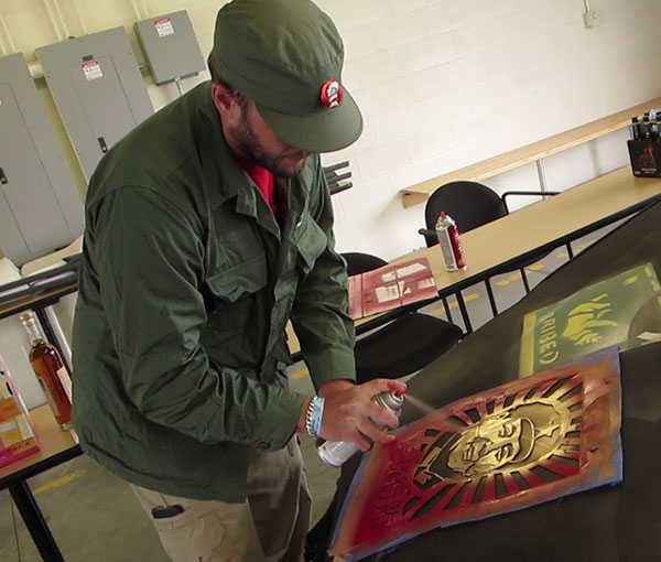 Judge Aaron Cole applying the Mao stencil at the 2015 Return of the LeMonites race