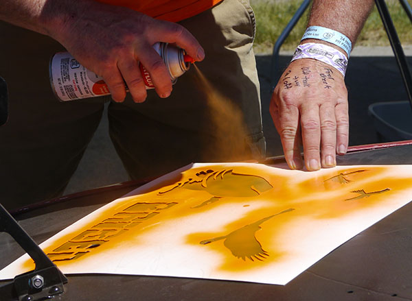 Judge Steve McDaniel spraying a BRIBED stencil at the 2015 Buttonwillow race
